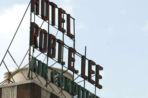 "The owner of the 10-story Robert E. Lee apartments is asking the city for permission to remove the Confederate commander's middle and last names, shortening the signs from ""Hotel Robt. E. Lee"" to ""Hotel Robt."""