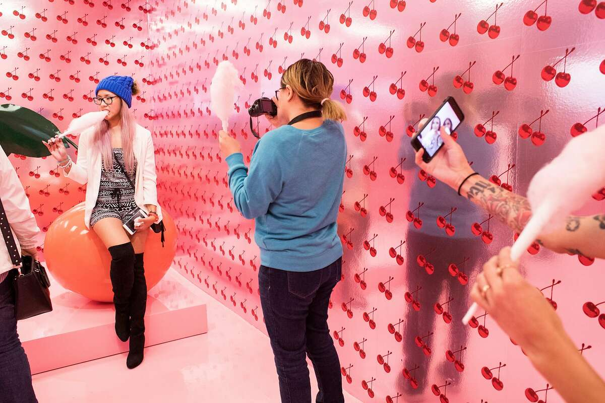 Linda Chan (center) takes photos of her sister Lulu Chan (left) in the Cherry on Top room at the Museum of Ice Cream in San Francisco, Calif., on Sunday, September 17, 2017. The pop-up exhibit opened in San Francisco on Sunday.