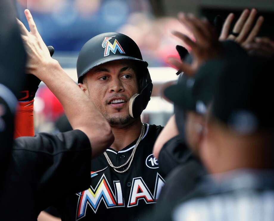 Miami Marlins' Giancarlo Stanton is congratulated after he hit a home run against the Philadelphia Phillies during the third inning of a baseball game Thursday, Aug. 24, 2017, in Philadelphia, Pa. (AP Photo/Rich Schultz) Photo: Rich Schultz, FRE / FR27227 AP