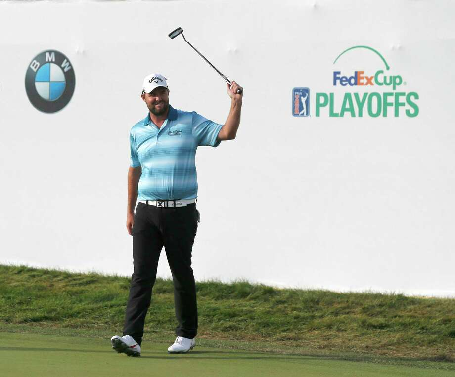 Marc Leishman celebrates after winning the BMW Championship golf tournament at Conway Farms Golf Club, Sunday, Sept. 17, 2017, in Lake Forest, Ill. (AP Photo/Charles Rex Arbogast) Photo: Charles Rex Arbogast, STF / Copyright 2017 The Associated Press. All rights reserved.