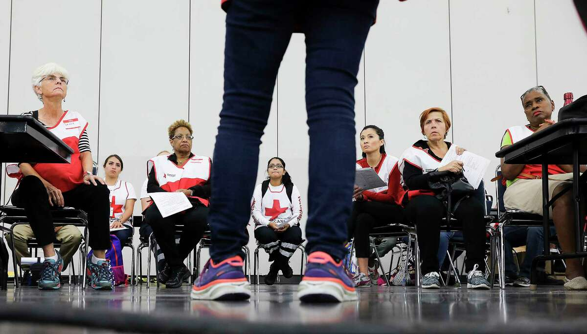 Red Cross manager Sue Engler instructs volunteers at the George R. Brown Convention Center on Sunday, Sept. 10, 2017, in Houston. ( Elizabeth Conley / Houston Chronicle )