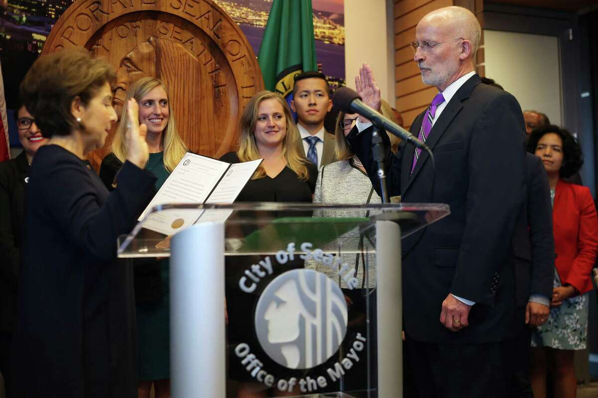 Tim Burgess is sworn in to office as the 55th Mayor of Seattle by city clerk Monica Martinez Simmons, Monday, Sept. 18, 2017. Burgess was voted into the position by his fellow city councilmembers, taking the place of Bruce Harrell who was sworn in last week, following Ed Murray's resignation. Harrell declined to hold the 91 day interim position.