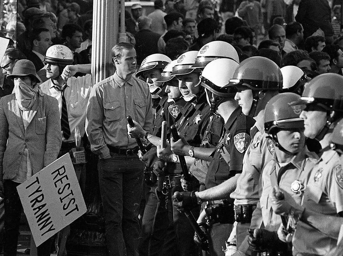 Anti-War protesters march against the Vietnam War and the draft at the Oakland Induction Center, October 20, 1967