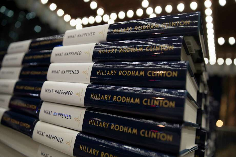"Stacks of Hillary Clinton's book ""What Happened"" are staged outside the Warner Theatre in Washington, Monday, Sept. 18, 2017, as Clinton participates in a book tour event hosted by the Politics and Prose bookstore. (AP Photo/Carolyn Kaster) Photo: Carolyn Kaster, STF / Copyright 2017 The Associated Press. All rights reserved."