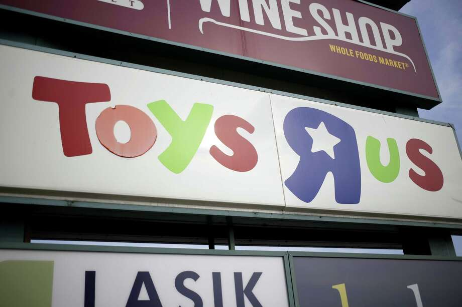 Signage stands outside a Toys R Us Inc. retail store in Louisville, Kentucky, U.S., on Monday, Sept. 18, 2017. Toys R Us Inc., which has struggled to lift its fortunes since a buyout loaded the retailer with debt more than a decade ago, is preparing a bankruptcy filing as soon as today, according to people familiar with the situation. Photographer: Luke Sharrett/Bloomberg Photo: Luke Sharrett / © 2017 Bloomberg Finance LP