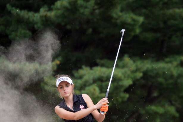 Edwardsville's Paige Hamel tries to hit her shot out of the bunker during Monday's Southwestern Conference dual match against O'Fallon at Tamarack Country Club in Shiloh.