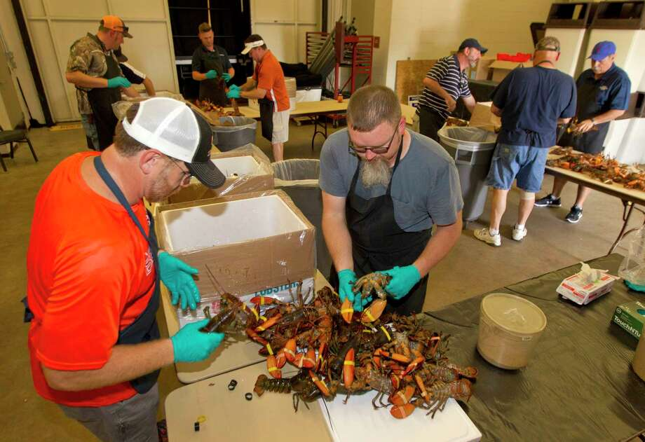 Volunteers unpack 750 lobsters in preparation for the Conroe/Lake Conroe Area Chamber of Commerce's annual Lobsterfest at Lone Star Convention Center Thursday, Oct. 6, 2016, in Conroe. Photo: Jason Fochtman, Staff / Houston Chronicle