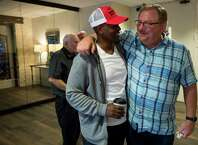 Terrence Johnson, left, speaks to Rick Warren, pastor of Saddleback Church in Califorinia, during a gathering of local pastors to encourage them in long-term Hurricane Harvey recovery efforts at First Baptist Church on Monday.