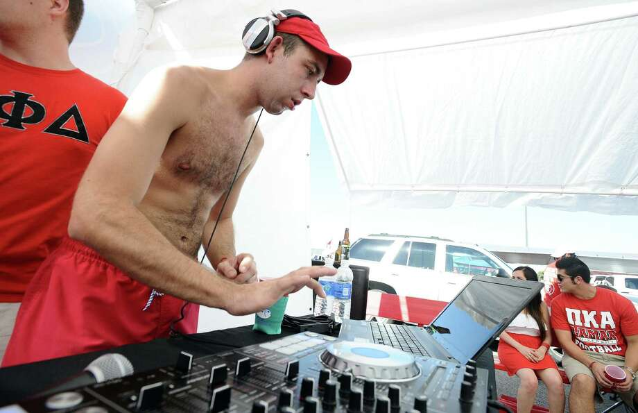 """Kyle Byrnes """"DJ Local"""" spins the hits in the Pi Kappa Alpha fraternity tailgating tent on Saturday, August 31, 2013, at Lamar University.   Photo taken: Randy Edwards/The Enterprise Photo: Randy Edwards, Photojournalist / Enterprise"""