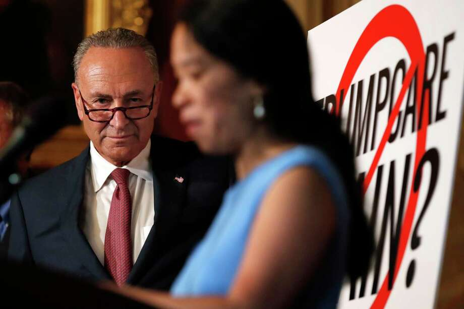 Senate Minority Leader Sen. Chuck Schumer of N.Y., left, listens as Elena Hung, Co-founder of Little Lobbyists, speaks about healthcare, Monday, Sept. 18, 2017, on Capitol Hill in Washington. Senate Republicans are revving up a final push to scuttle President Barack Obama's health care law. Though the effort faces low odds of success and just a two-week window to prevail, Democrats backed by doctors, hospitals, and patients' groups are mustering an all-out effort to smother the GOP drive once and for all. (AP Photo/Jacquelyn Martin) ORG XMIT: DCJM103 Photo: Jacquelyn Martin / Copyright 2017 The Associated Press. All rights reserved.
