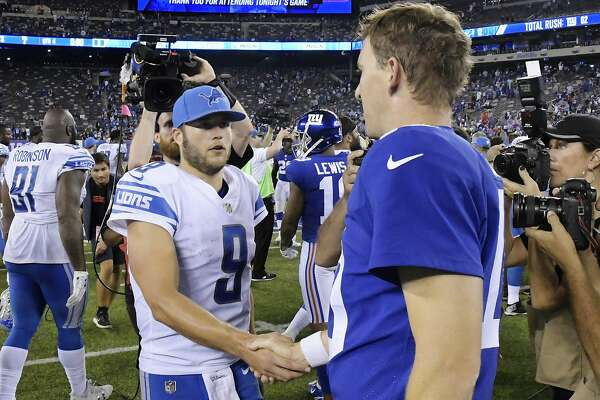 Detroit Lions quarterback Matt Stafford, left, shakes hands with New York Giants' Eli Manning after an NFL football game Monday, Sept. 18, 2017, in East Rutherford, N.J. The Lions won 24-10. (AP Photo/Bill Kostroun)