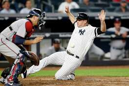 Minnesota Twins catcher Jason Castro waits for the throw as New York Yankees designated hitter Chase Headley scores on Todd Frazier's sixth-inning sacrifice fly in a baseball game in New York, Monday, Sept. 18, 2017. (AP Photo/Kathy Willens) ORG XMIT: NYY107