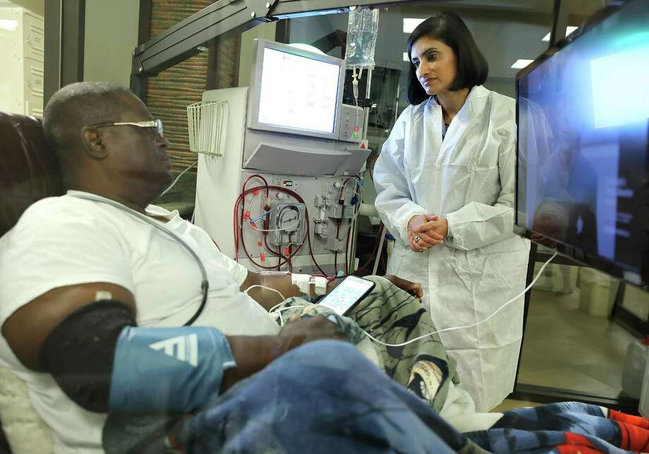 Seema Verma, director of the Centers for Medicare and Medicaid, talks with Zachary Gay as he's given dialysis Monday.  Photo: Elizabeth Conley, Staff / © 2017 Houston Chronicle