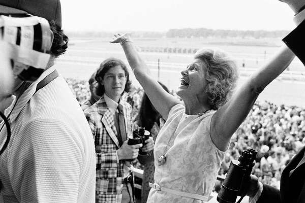 FILE - This June 9, 1973, file photo shows Penny Chenery, owner of Secretariat, reacting after her horse won the Belmont Stakes, and the Triple Crown, at Belmont Park in Elmont, N.Y. Chenery, who bred and raced 1973 Triple Crown winner Secretariat as well as realizing her disabled father's dream to win the Kentucky Derby in 1972 with Riva Ridge, died Saturday, Sept. 16, 2017, at her Boulder, Colo. home following complications from a stroke, her children announced Sunday through Leonard Lusky, her longtime friend and business partner. She was 95.  (AP Photo/Jack Kanthal, File) ORG XMIT: NY161