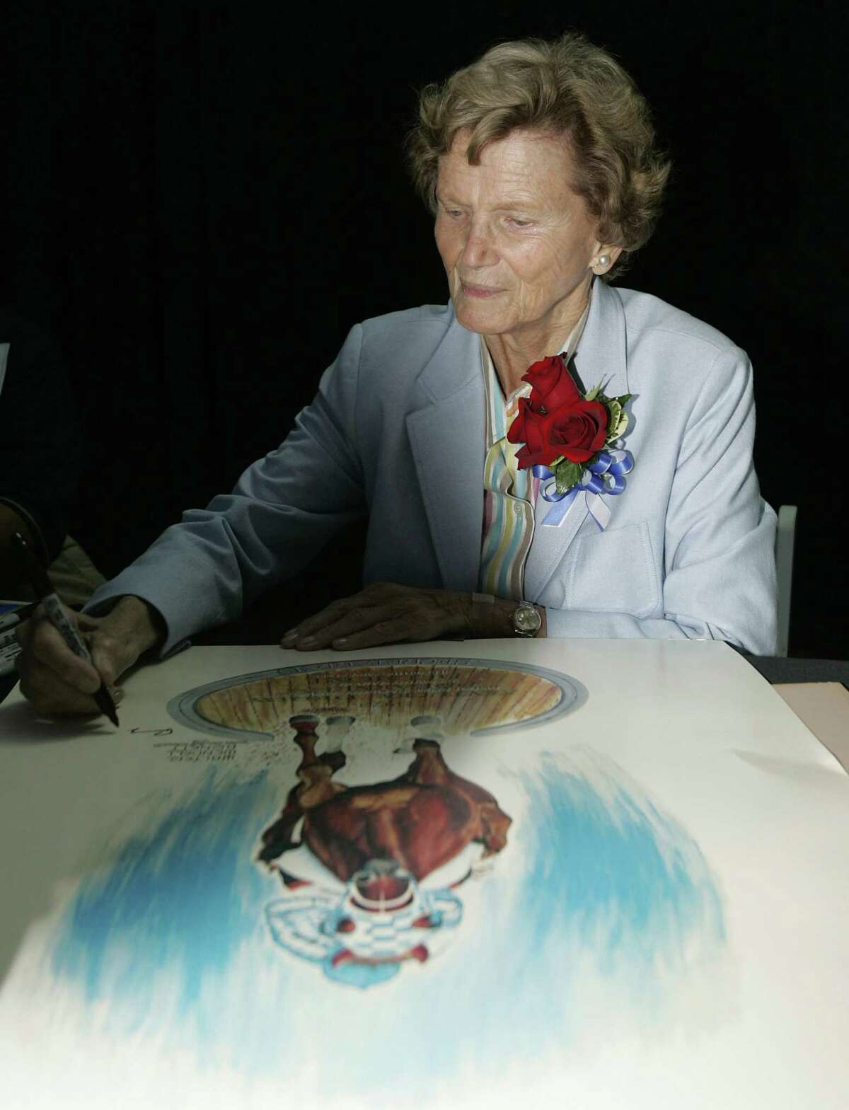 FILE - In this July 17, 2004, file photo, Secretariat owner Penny Chenery, signs some autographs as The Kentucky Horse Park unveils a statue of the 1973 Triple Crown winner Secretariat, during