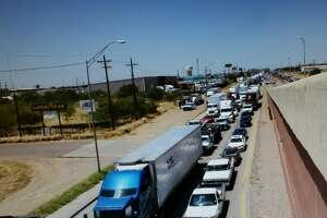 Traffic on Mines Road is shown in this file photo.