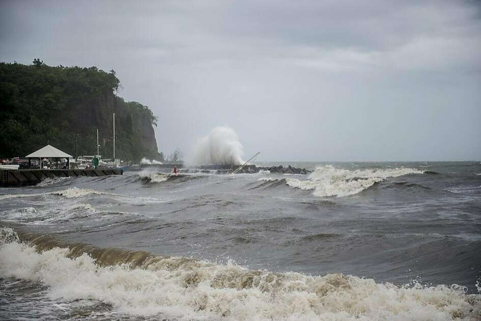 A picture shows strong waves along the coastline in Le Carbet, on the French Caribbean island of Martinique, after it was hit by Hurricane Maria, on September 19, 2017. Hurricane Maria smashed into the eastern Caribbean island of Dominica on September 19, with its prime minister describing devastating damage as winds and rain from the storm also hit territories still reeling from Irma. Martinique, a French island south of Dominica, suffered power outages but avoided major damage. / AFP PHOTO / Lionel CHAMOISEAULIONEL CHAMOISEAU/AFP/Getty Images
