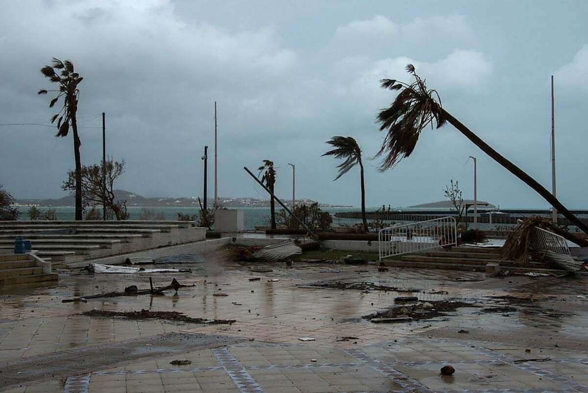 A photo shows debris in a street in Marigot, on the French Caribbean island of Saint Martin, as preparations were made for the arrival of Hurricane Maria on September 19, 2017. Hurricane Maria strengthened into a