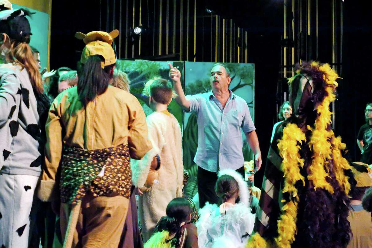Kids' Backporch Productions Director Ron Solomon gives cast members directions following a matinee presentation of