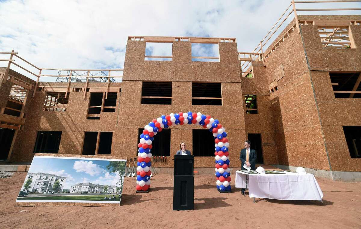 Evonne Klein, Commissioner of the Connecticut Department of Housing, speaks at a construction celebration ceremony for Hamden Specialty Housing on September 18, 2017. At right is Ken Regan, vice president of Regan Development. Arnold Gold / Hearst Connecticut Media