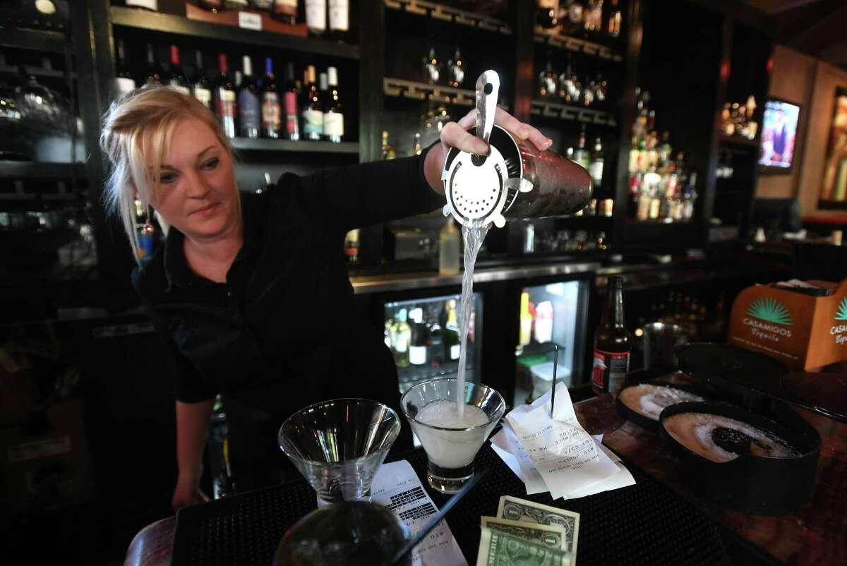 Sierra Lester prepares a martini during the Cabana's Happy Hour on Thursday. Photo taken Thursday, September 15, 2017as Guiseppe Barranco/The Enterprise