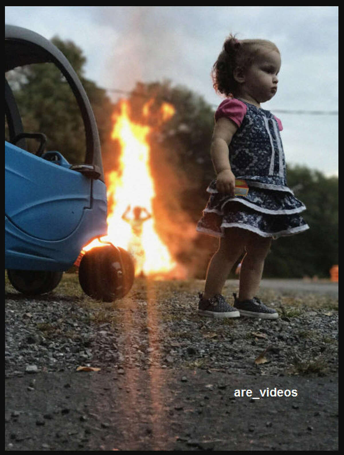 Photo Of Girl Standing Stoically By Fire Is The Latest And Greatest Internet Meme