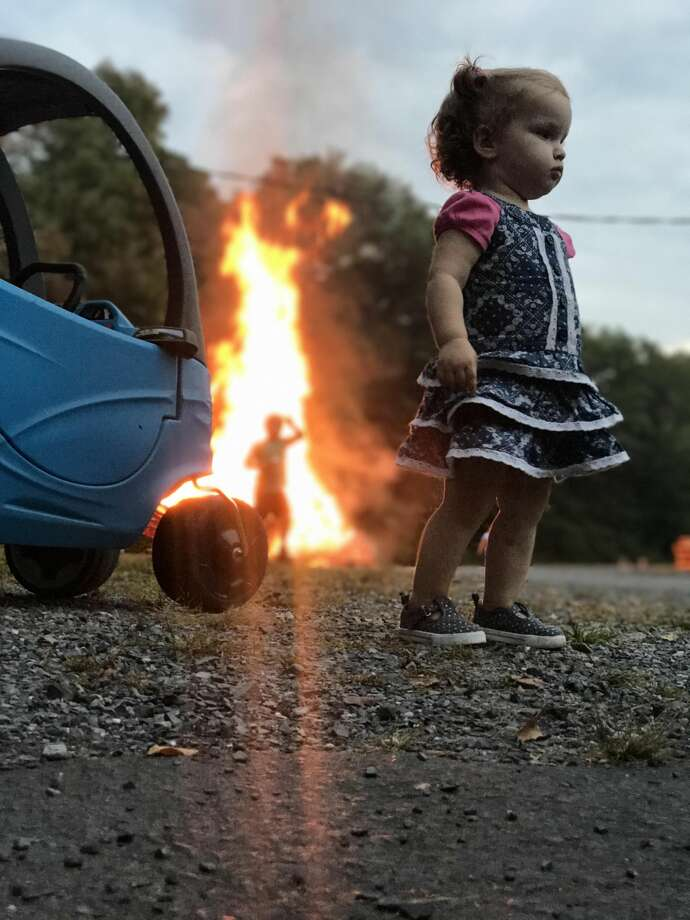 An 18-month-old girl has become an overnight internet sensation thanks to a quick photo her dad took while they were camping in Pennsylvania. Photo: Reddit R/photoshopbattles