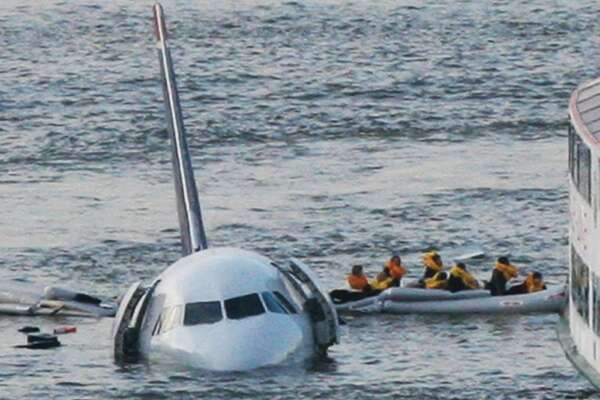 Passengers in an inflatable raft move away from an Airbus 320 US Airways aircraft that went down in 2009 in the Hudson River in New York. More than seven years after an airline captain saved 155 lives by ditching his crippled airliner in the Hudson River, now the basis of a movie, most of the safety recommendations stemming from the accident have yet to be followed.