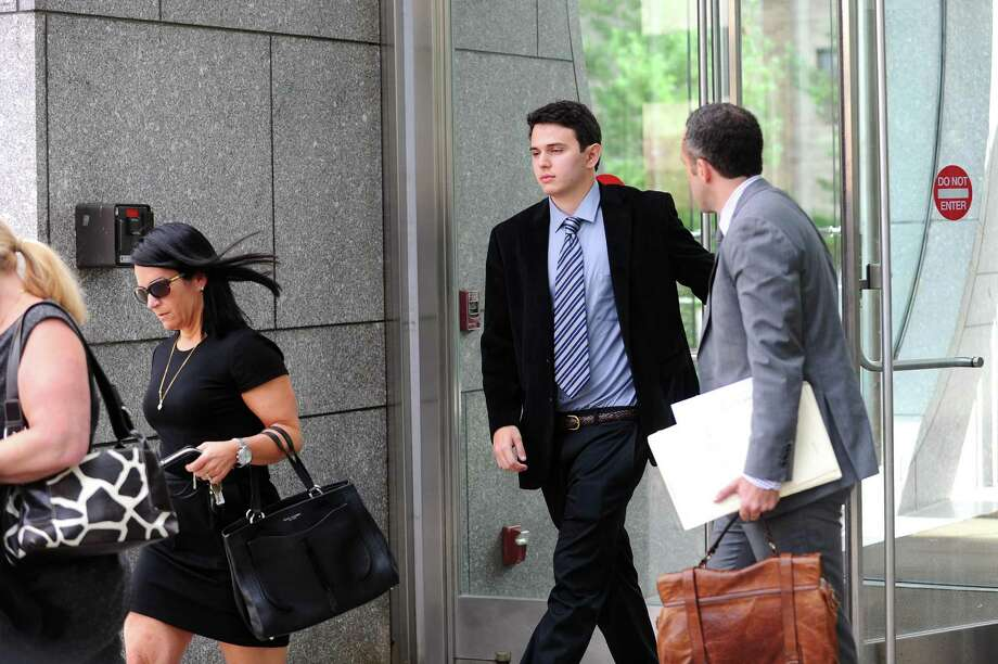 Zachary Stein, a 23-year-old New Canaan resident, leaves the Stamford Superior Court after being arraigned in Stamford, Conn. on Tuesday, Sept. 19, 2017. The former Chelsea Piers lifeguard has been charged in the near-drowning of a 5-year-old boy at the Stamford facility. Photo: Michael Cummo / Hearst Connecticut Media / Stamford Advocate