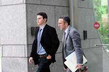 From left, Zachary Stein, 23, of New Canaan, and attorney Mark Sherman leave the Stamford courthouse on Tuesday.