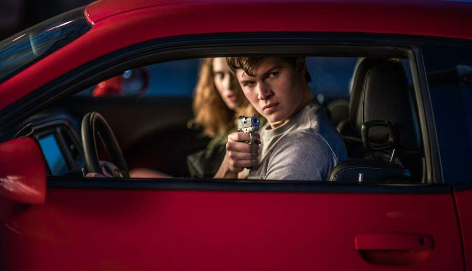 """Baby (Ansel Elgort) and Debora (Lily James) jack a car to get away in """"Baby Driver."""" Photo: Wilson Webb /Sony Pictures Entertainment / ©2017 TriStar Pictures, Inc. and MRC II Distribution Company L.P."""