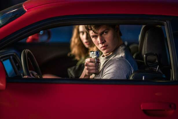 """Baby (Ansel Elgort) and Debora (Lily James) jack a car to get away in """"Baby Driver."""""""