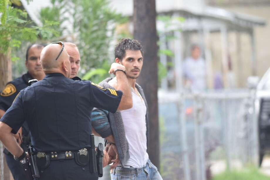 A man was arrested Tuesday after crashing a stolen pickup truck and trailer on the North Side, fleeing and then hiding in the backyard of a West Side residence for about an hour. Photo: Caleb Downs / San Antonio Express-News