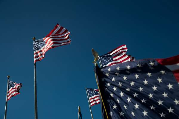 JERSEY CITY, NJ - SEPTEMBER 15: American flags fly during a naturalization ceremony at Liberty State Park, September 15, 2017 in Jersey City, New Jersey. To mark Citizenship Day, 35 immigrants became United States citizens during the ceremony. (Photo by Drew Angerer/Getty Images)