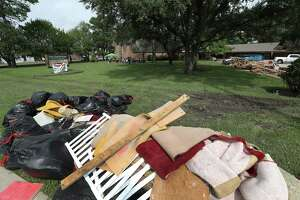 Debris lines the property of The First Presbyterian Church of Dickinson while a outside worship service was held on the front lawn Sunday, Sept. 3 in Dickinson. First Presbyterian Church of Dickinson was badly damaged in the floods from Hurricane Harvey, with only the stained glass left undam aged..