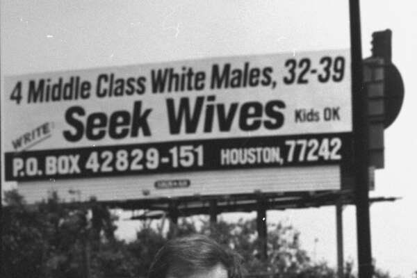 Research technician Bill Machmer, 40, divorced since 1990, holding handful of letters as he stands in front of roadside billboard emblazoned w. 4 MIDDLE CLASS WHITE MALES, 32-39, SEEK WIVES, KIDS OK, WRITE PO BOX 42829-151 HOUSTON for which he & 3 men ea.ch paid $2500-a-mo. (Photo by Mark Perlstein/The LIFE Images Collection/Getty Images)