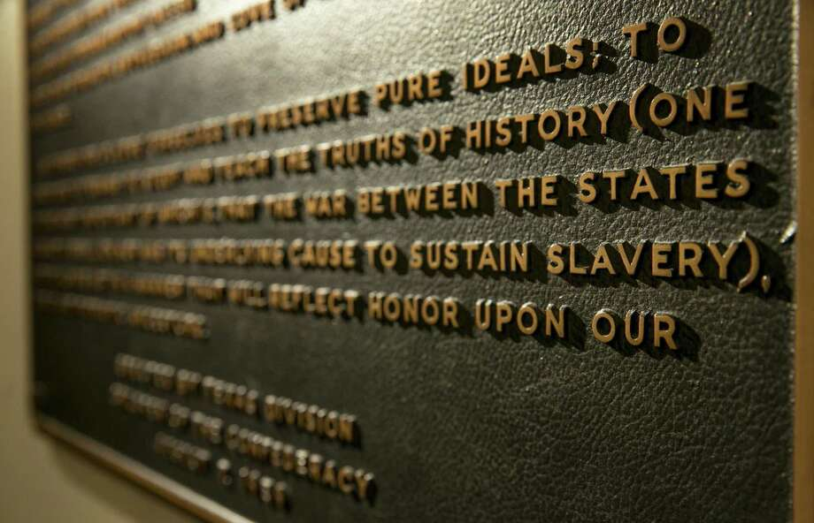 """A Thursday Aug. 17, 2017 photo shows the Children of the Confederacy Creed plaque at the Capitol in Austin, Texas.  A powerful Texas Republican is calling for the removal of the Confederate marker in the state Capitol that rejects slavery as an underlying cause of the Civil War. Republican House Speaker Joe Straus said Tuesday, Sept. 19, in a letter to state officials that the plaque is """"blatantly inaccurate.""""(Jay Janner/Austin American-Statesman via AP) Photo: Jay Janner, MBO / Associated Press / Austin American-Statesman"""