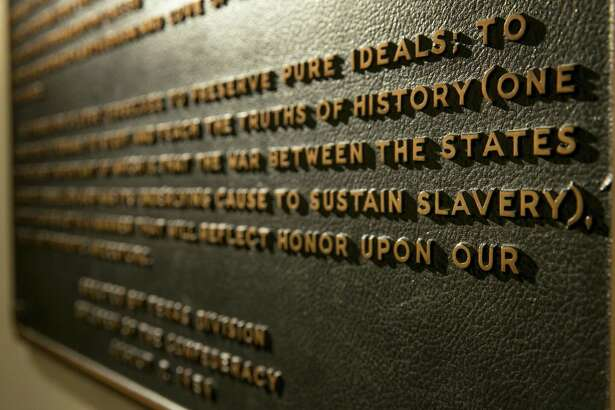 """A Thursday Aug. 17, 2017 photo shows the Children of the Confederacy Creed plaque at the Capitol in Austin, Texas.  A powerful Texas Republican is calling for the removal of the Confederate marker in the state Capitol that rejects slavery as an underlying cause of the Civil War. Republican House Speaker Joe Straus said Tuesday, Sept. 19, in a letter to state officials that the plaque is """"blatantly inaccurate.""""(Jay Janner/Austin American-Statesman via AP)"""