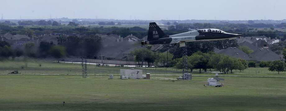 A U.S. Air Force T-38 trainer takes off from Joint Base San Antonio-Randolph Monday August 21, 2017 near Schertz, Texas. The planes are taking off near an area known as an APZ or Accident Potential Zone. Subdivisions are currently being built in areas close to these APZ areas. Photo: John Davenport, STAFF / San Antonio Express-News / ©John Davenport/San Antonio Express-News