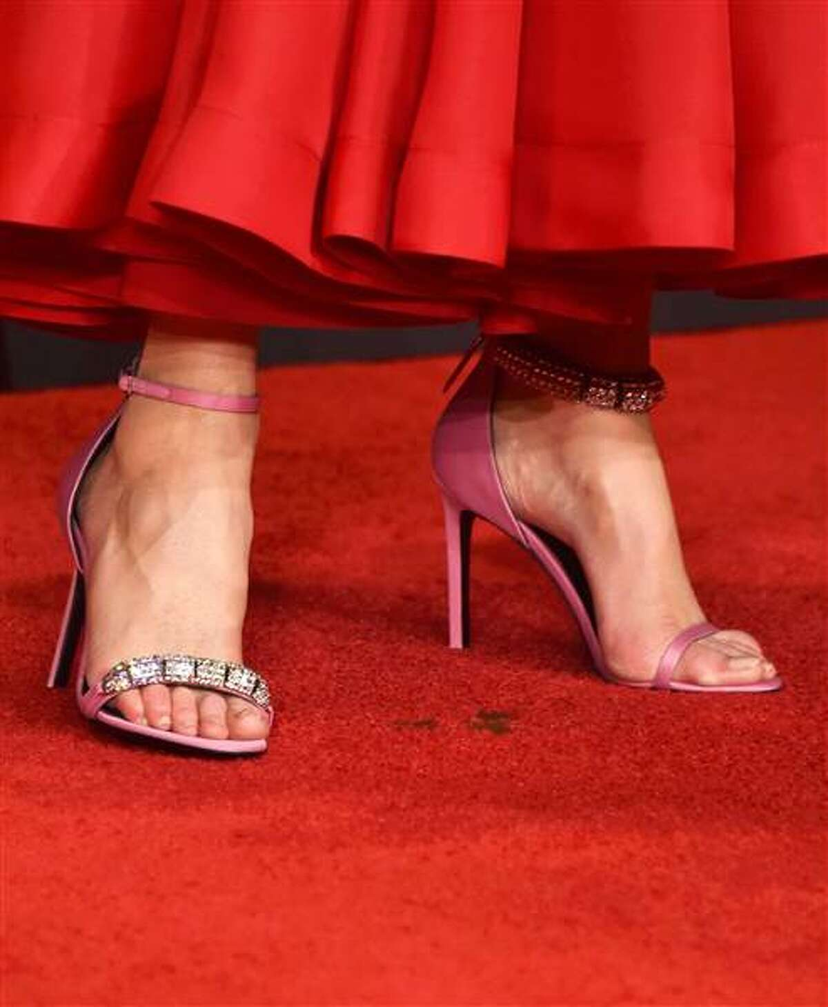 Nicole Kidman wore a mismatched pair of Calvin Klein sandals to contrast her red Calvin Klein dress at the recent Emmys.