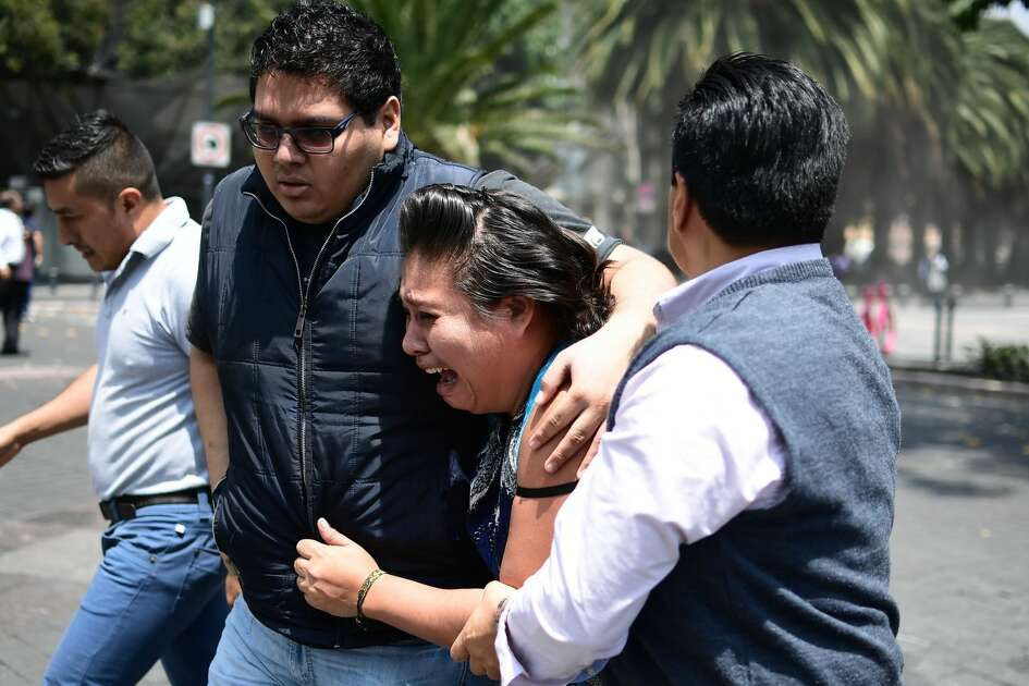 People react as a real quake rattles Mexico City on September 19, 2017 as an earthquake drill was being held in the capital.