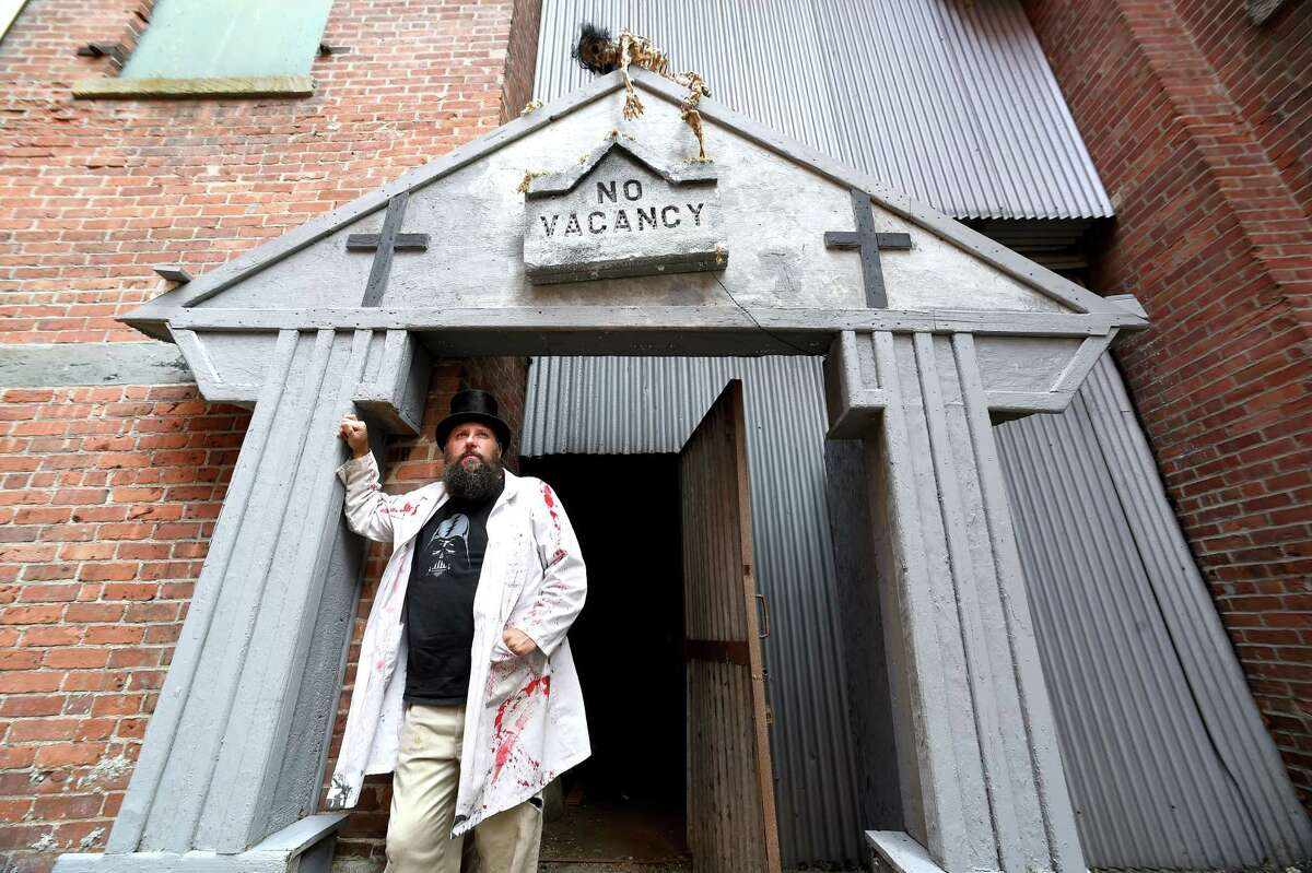 Mike Yachymczyk, owner and operator of Fat Freddy's House of Horror ,is photographed at the entrance to the haunted tour in the basement of the Conti Building in Shelton on September 19, 2017. The house of horror opens on September 29th. Arnold Gold / Hearst Connecticut Media