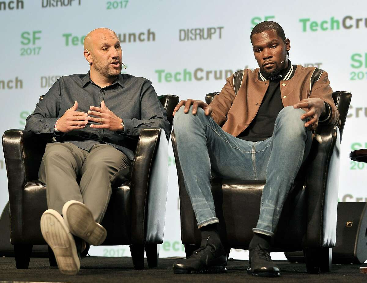 FILE -- Rich Kleiman (left) and NBA player Kevin Durant, business partners at the angel investment firm Durant Company/Thirty Five Media Partner, speak onstage during TechCrunch Disrupt SF in San Francisco in this September 19, 2017 file photo.