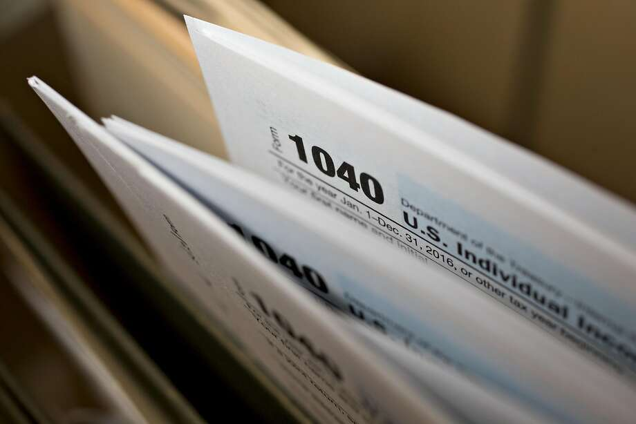 U.S. Department of the Treasury Internal Revenue Service (IRS) 1040 Individual Income Tax forms for the 2016 tax year are arranged for a photograph in Tiskilwa, Illinois, U.S., on Tuesday, March 28, 2017. Due to the Emancipation day holiday, this year's income taxes will need to be filed by April 18 instead of April 15. Photographer: Daniel Acker/Bloomberg Photo: Daniel Acker, Bloomberg