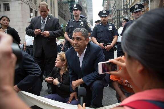 NEW YORK, NY - SEPTEMBER 19, 2017: Activists, including City Council Speaker Melissa Mark-Viverito and Rep. Adriano Espaillat, sit on Fifth Avenue in an action of civil disobedience near Trump Tower on September 19, 2017 in New York, New York. The action was intended to call attention to President Donald Trump's anti-immigration policies, including the rollback of DACA. (Photo by Kevin Hagen/Getty Images)