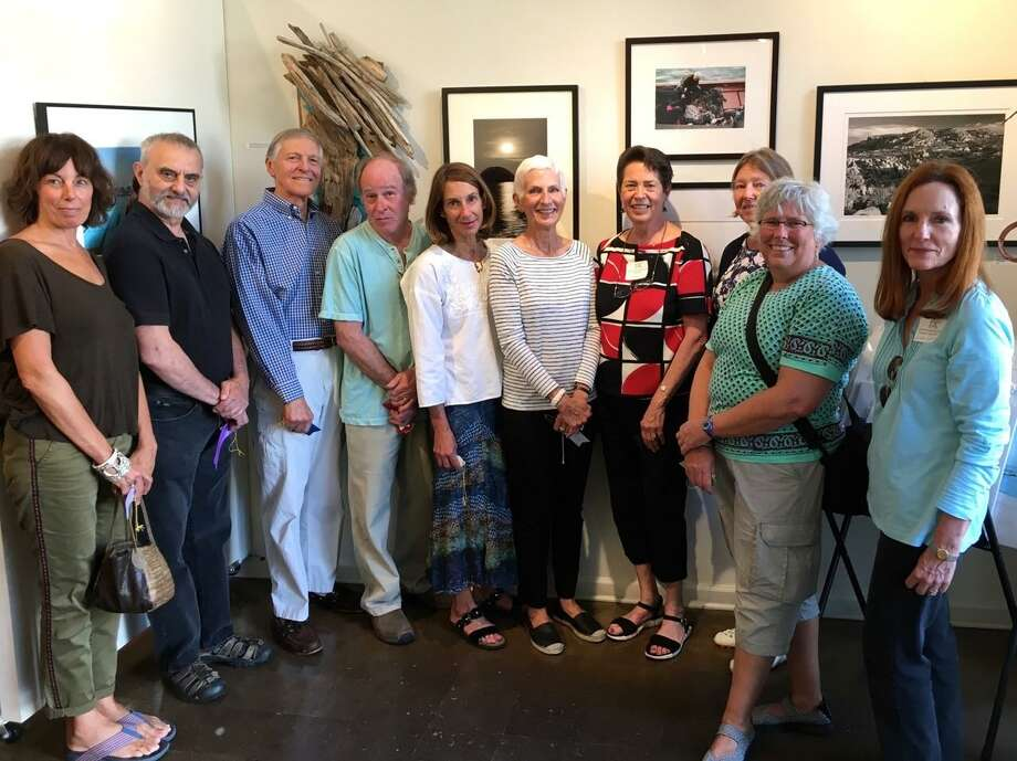 A few of the winners of the Rowayton Arts Center 2017 Photography and Sculpture Exhibition line up in the gallery. From left to right: Debbie Smith (Westport), Richard Ventre (Norwalk), Alan Sprules (Rowayton), Mark Ferguson (Norwalk), Emily Kelting (Norwalk), Laure Dunne (Norwalk), Barbara Murphy (Norwalk), Katharine Draper (Norwalk), Dana Laird (Rowayton) and Susan Acker (Stamford). Photo: Contributed Photo