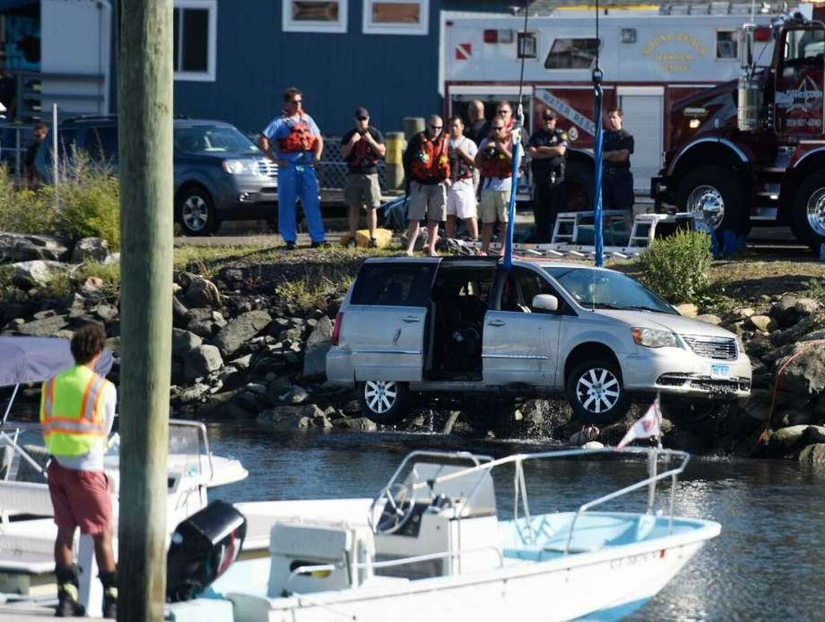 A crane pulls a minivan out of the water following a fatal accident at the Cos Cob Marina in September of 2015.