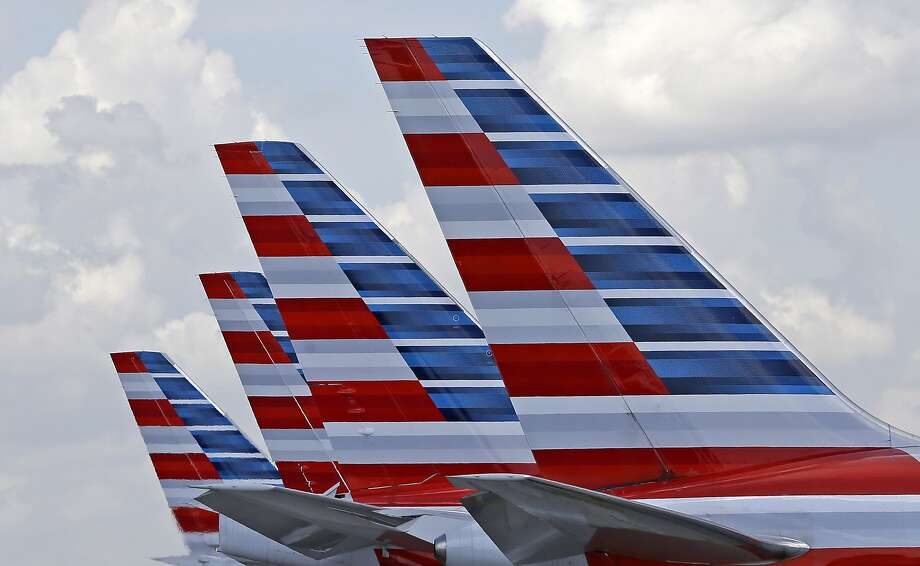 This file photo shows the tails of four American Airlines passenger planes parked at Miami International Airport, in Miami.  Photo: Alan Diaz, Associated Press