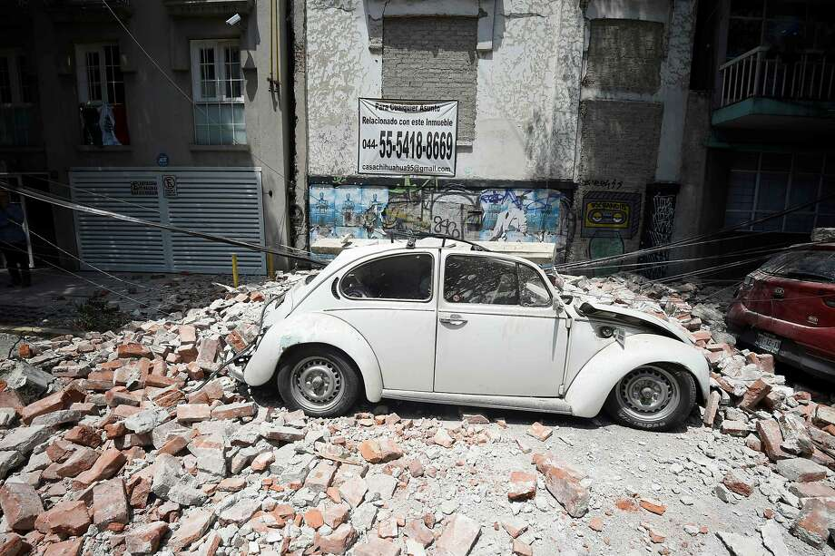 Picture of a car crashed by debris from a damaged building after a quake rattled Mexico City on September 19, 2017. A powerful earthquake shook Mexico City on Tuesday, causing panic among the megalopolis' 20 million inhabitants on the 32nd anniversary of a devastating 1985 quake. The US Geological Survey put the quake's magnitude at 7.1 while Mexico's Seismological Institute said it measured 6.8 on its scale. The institute said the quake's epicenter was seven kilometers west of Chiautla de Tapia, in the neighboring state of Puebla. Photo: ALFREDO ESTRELLA, AFP/Getty Images