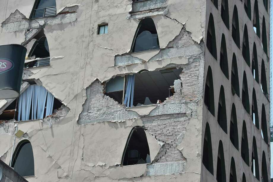 Picture of the damages caused on a building by a powerful quake in Mexico City on September 19, 2017. A powerful earthquake shook Mexico City on Tuesday, causing panic among the megalopolis' 20 million inhabitants on the 32nd anniversary of a devastating 1985 quake. The US Geological Survey put the quake's magnitude at 7.1 while Mexico's Seismological Institute said it measured 6.8 on its scale. The institute said the quake's epicenter was seven kilometers west of Chiautla de Tapia, in the neighboring state of Puebla.  / AFP PHOTO / Yuri CORTEZYURI CORTEZ/AFP/Getty Images Photo: YURI CORTEZ, Contributor / AFP/Getty Images / AFP or licensors